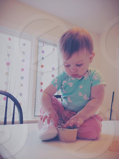 Little toddler girl sitting on table  photo