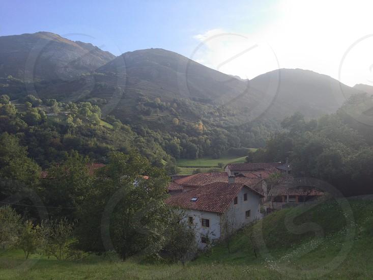 white concrete houses near mountains photo