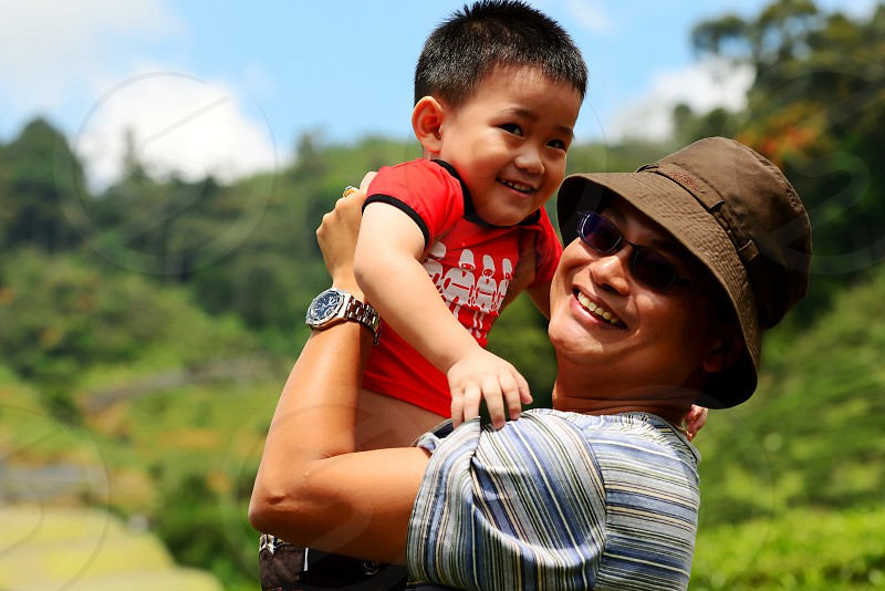 We took our retreat in the green rolling hill of tea plants 'Cameron Highlands' during Father's Day with the scenic tranquil & cool fresh air. photo