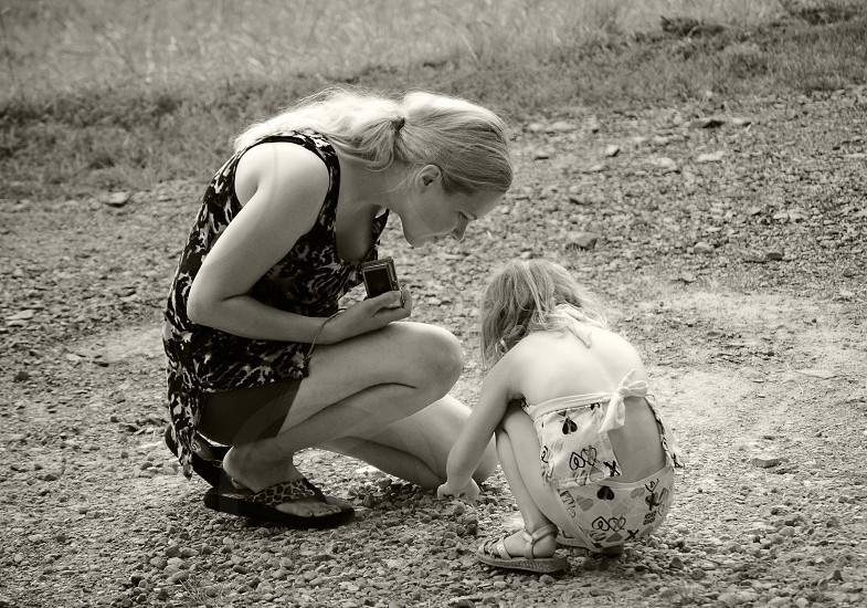 Mother daughter curiosity distracted black white child woman photo