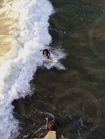 person riding surfboard aerial view photo