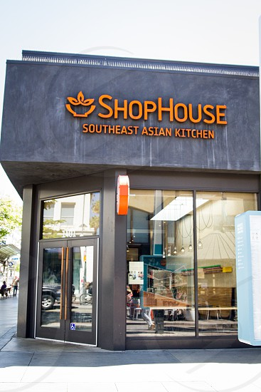 closed black door of shophouse southeast asian kitchen during daytime photo