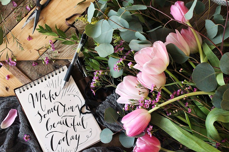 'Make Something Beautiful Today': Handlettered modern calligraphy with fresh tulips and eucalyptus. photo