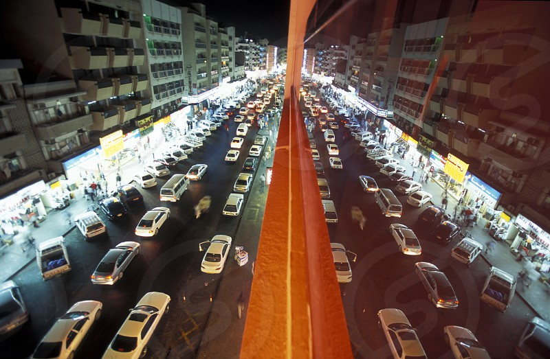 a road at night in the old town in the city of Dubai in the Arab Emirates in the Gulf of Arabia. photo