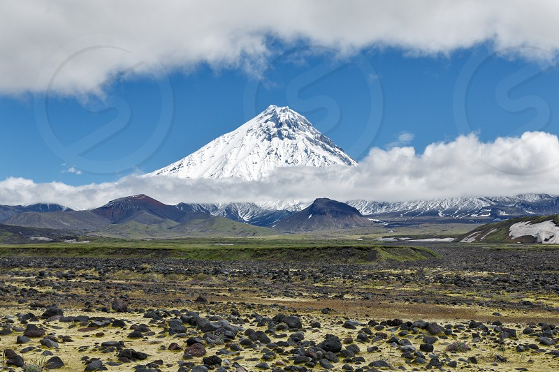 Nature of Kamchatka - beautiful volcanic landscape: view on Kamen Volcano. Klyuchevskaya Group of Volcanoes Kamchatka Peninsula Russian Far East Eurasia. photo