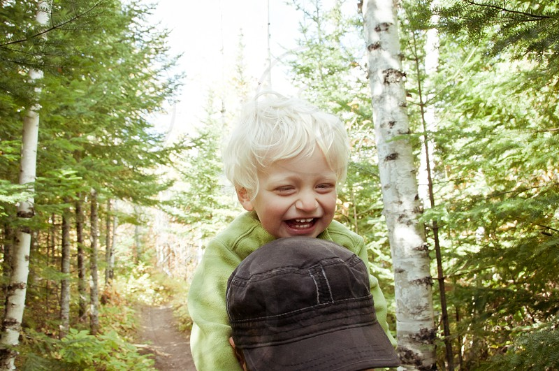 active family hike hiking walking boy son father happy smile laugh smiling blonde woods trees forest trail summer exercise camping outside outdoors exploring photo