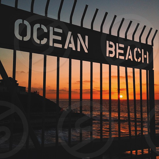 Ocean beach fence photo