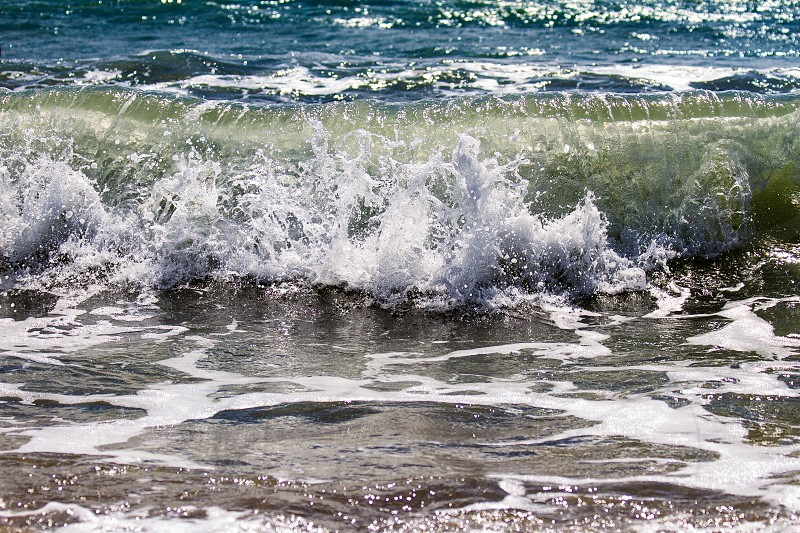 Wave breaking near the shore photo