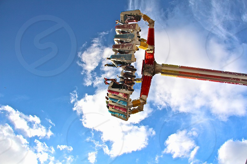 red and silver metal rod under white cloudy blue sky during daytime photo