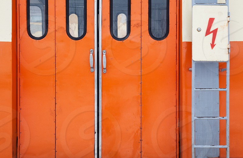 Closeup view on orange closed wagon door.  photo