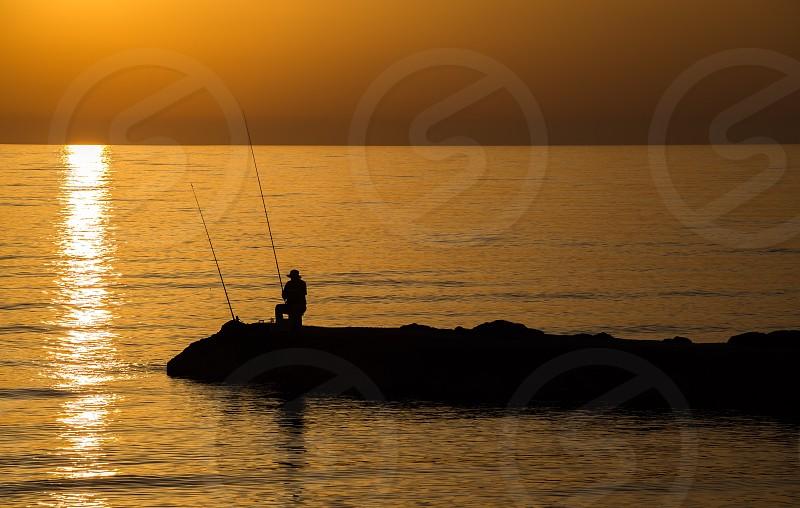 Sea fisherman silhouette monochrome Cyprus sunset mood travel photo