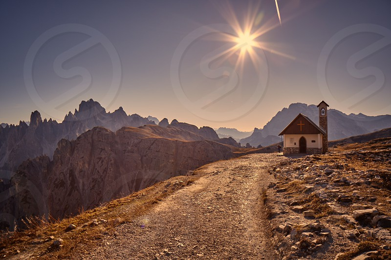 dolomitesalpsitalymountainssunraysheightshikingitalychurchchapel photo