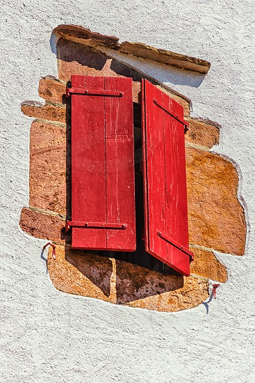 Closed red shutter photo