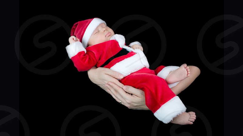 baby wearing Santa Clause costume photo