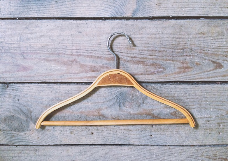 wood hanger hanging on a wood porch photo