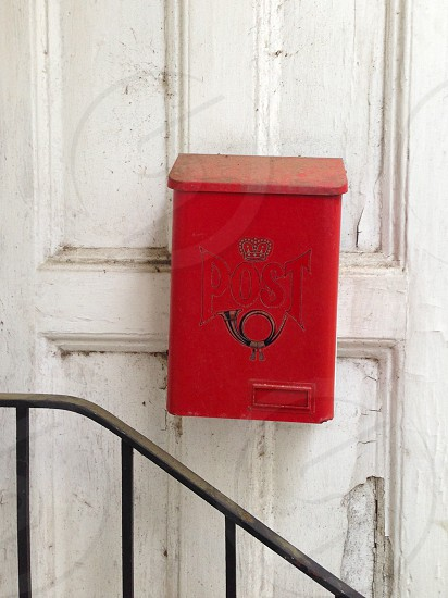 Vintage postbox on chippy door photo