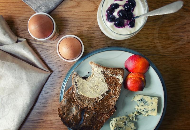 kitchen brrakfast toast eggs fruit rustic plates napkins linen wooden wooden table cheese photo