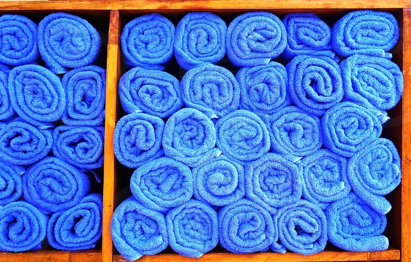 Rolled blue pool towels photo