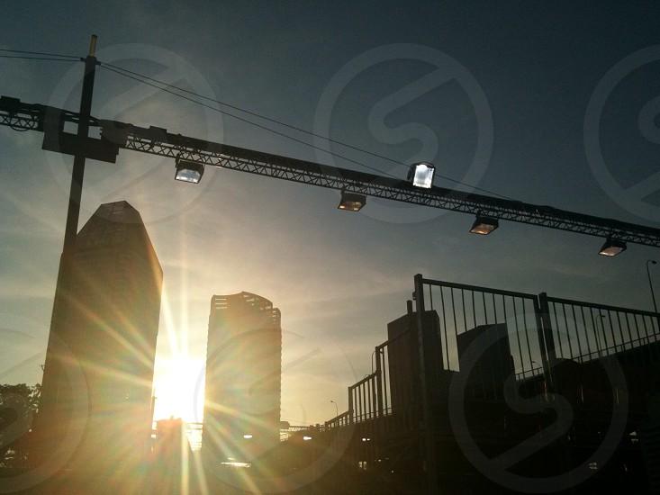 sun behind city buildings photo