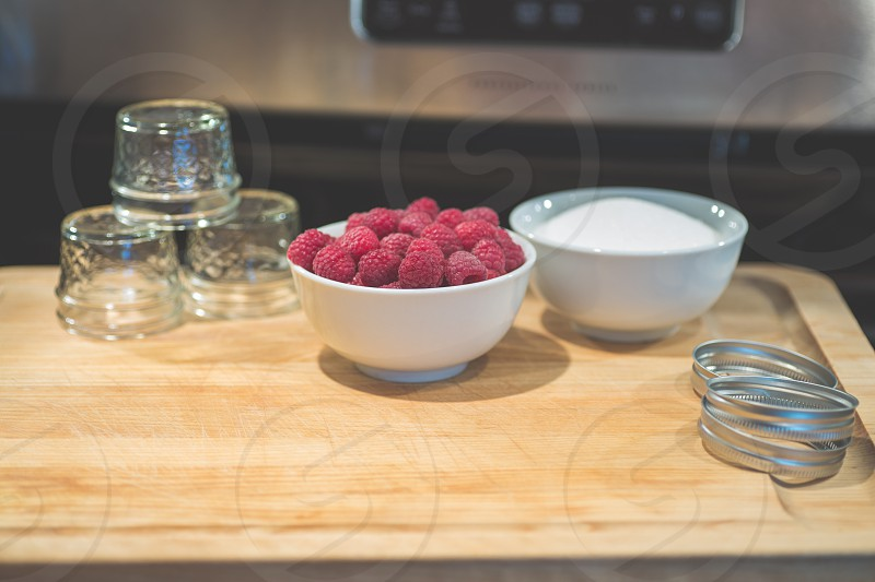 Getting ready to make raspberry jam or jelly canning photo