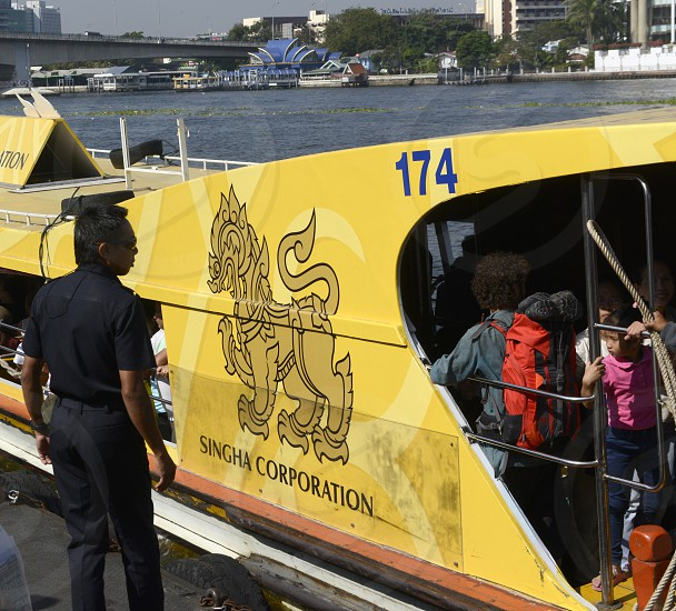a tourist boat with singha beer promotion on the chao phraya river in Banglamphu in the city of Bangkok in Thailand in Southeastasia. photo