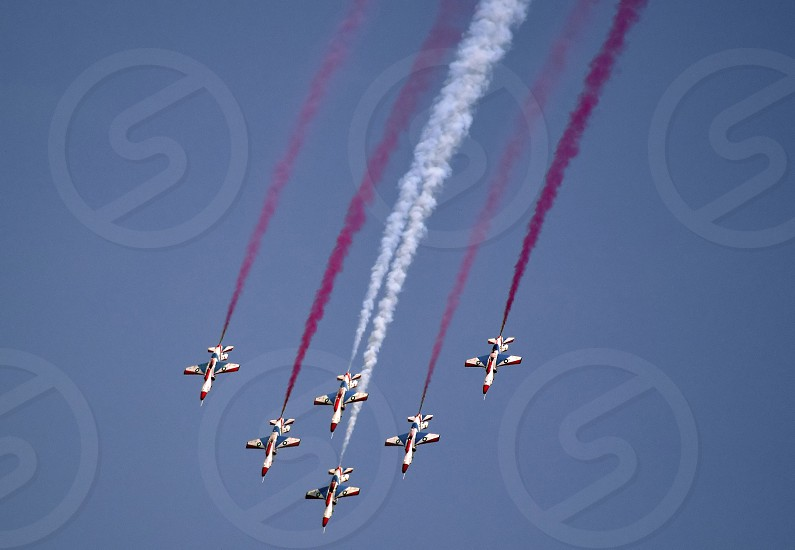 Pakistan Air force 'Sherdils' Squadron performing aerobatics on Pakistan Defense Day to commemorate the sacrifices rendered by Pakistani servicemen in the 1965 war against India. photo