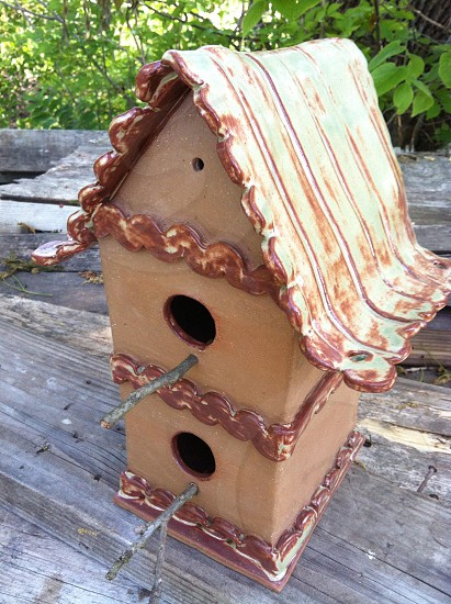 Birdhouse on wooden table photo