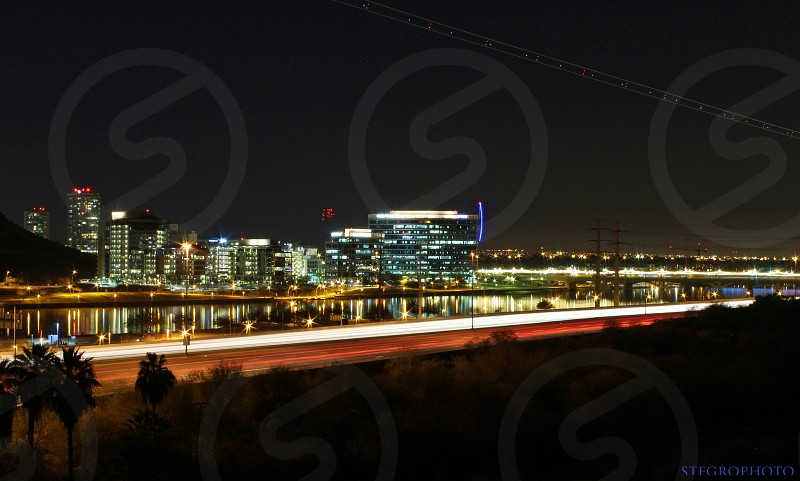 I hiked and rock climbed up on top of this rock to get a good view of the freeway Tempe Town Lake and downtown Tempe with passing by planes landing at the airport. It was a very fun night. Photo turned out great! photo