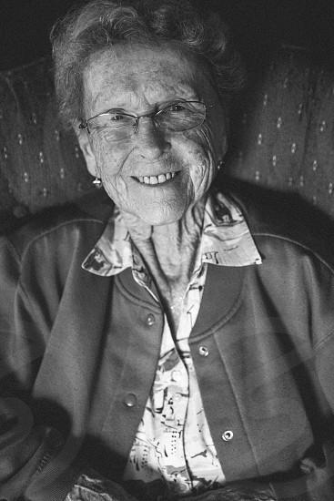 woman in grey coat smiling photo