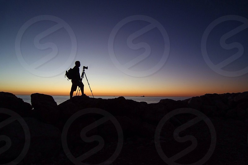Photographer dslr tripod sunrise backpack silhouette  photo