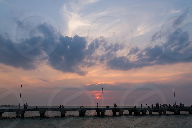 A sunset in the sea dock in Progreso Yucatan Mexico. photo