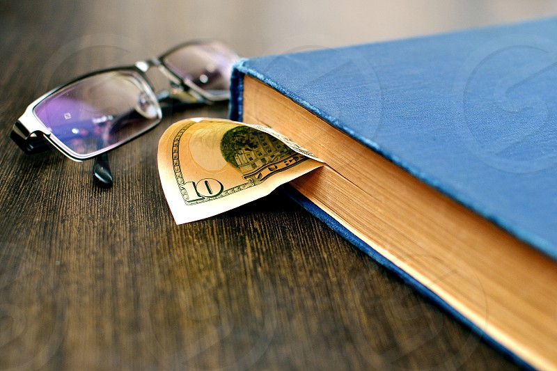 money cash books dollar glasses glass table business photo