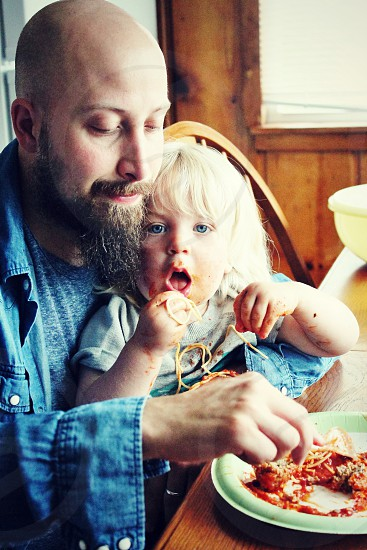Father son child toddler eating dinner spaghetti vacation mealtime  bonding photo