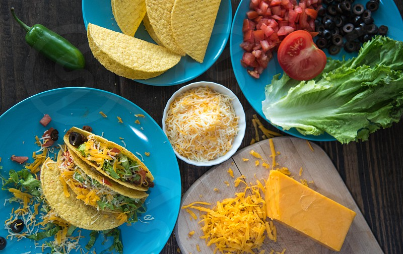 Tacos on plate with cheese hero photo