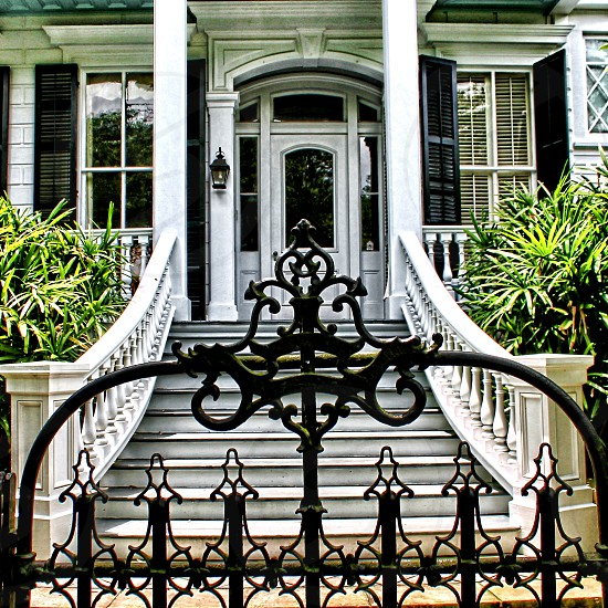 Mansion behind an iron gate New Orleans LA photo