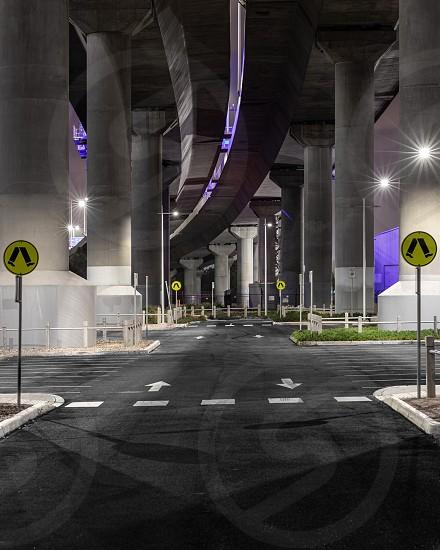 Street signs bridge concrete night after dark concrete pillars car park parking bay Melbourne photo