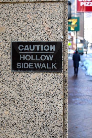 caution hollow sidewalk sign photo