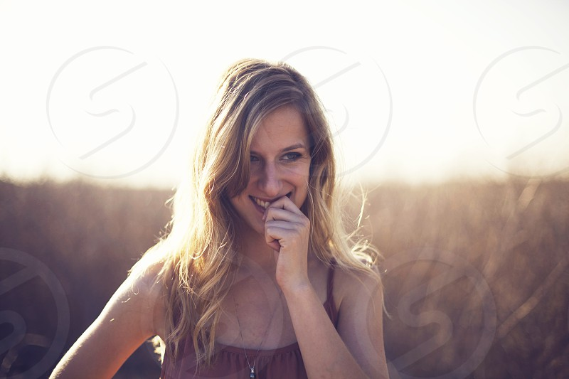 woman biting her finger photo