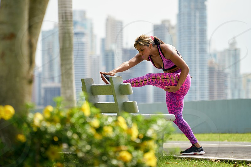 woman city exercise stretching sport fitness workout 20s active adult african american athlete beautiful bench black buildings cinta costera clothing exercising female girl latin america leg legs lifestyle long shot morning muscular one outdoor outdoors Panama park people person preparation skyline skyscraper sports sportswear street train training urban warm up warming up weightloss wellness working out young photo