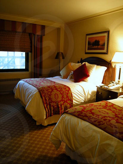 Hotel with two beds gold walls and red and gold decor photo