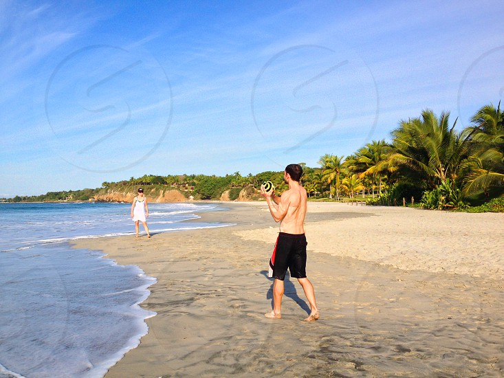 playing football on a tropical beach photo