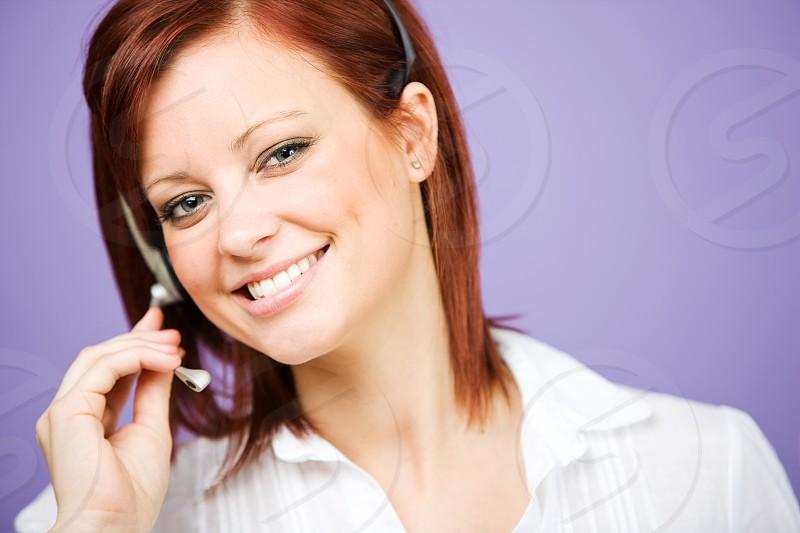 CSR: Friendly Customer Service Agent on Headset photo