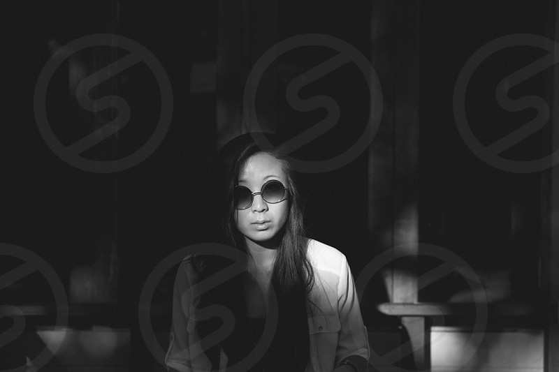 woman wearing frameless sunglasses and white button down shirt photo