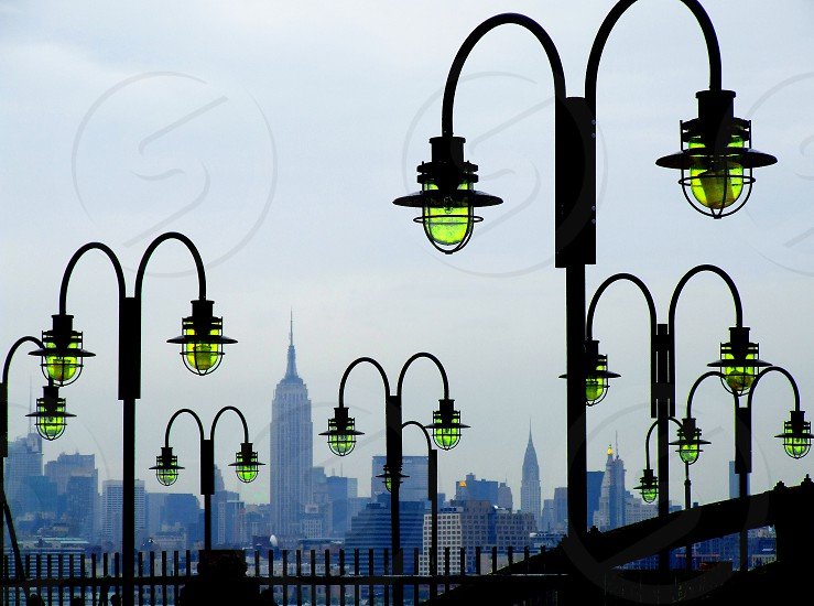 Manhattan skyline seen through old lampposts from Liberty Park in New Jersey. photo