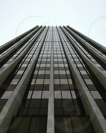 low angle of gray painted high-rise building photo