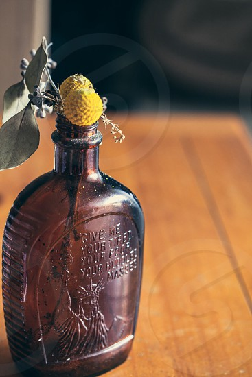 brown embossed glass bottle photo