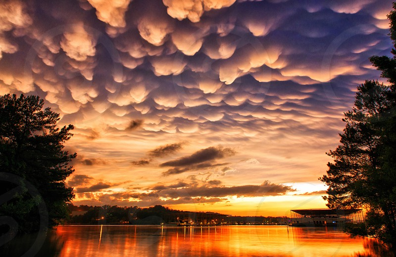 Rare Mammatus Clouds over a lake at Sunset after a sudden intense storm. photo