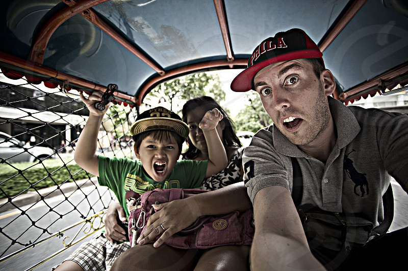 family selfie inside a tuktuk car taxi on a happy father day photo
