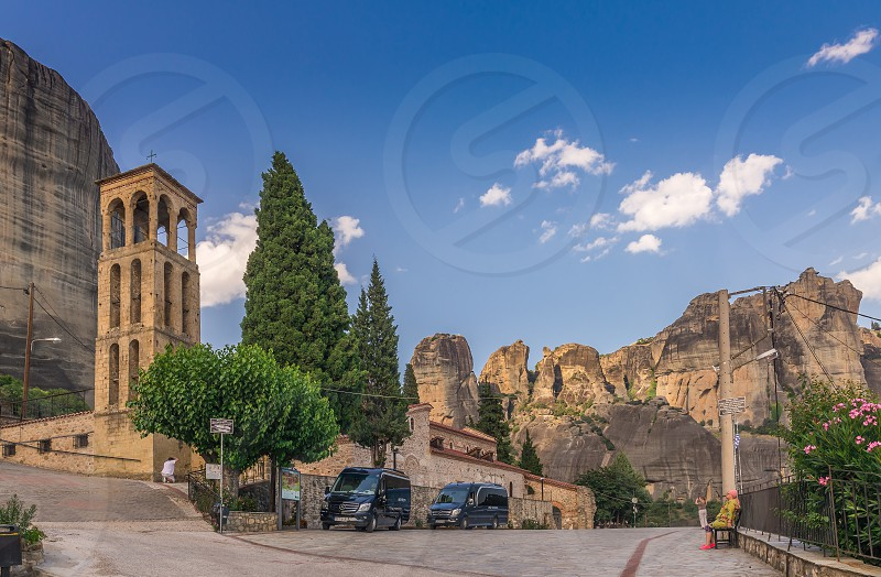 Meteora Greece - 07.04.2018. Panoramic view of the Assumption of Virgin Mary byzantine church in Meteora Kalambaka town in Greece on a sunny summer day photo