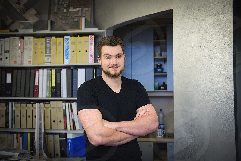 a portrait of a young architect in his office photo